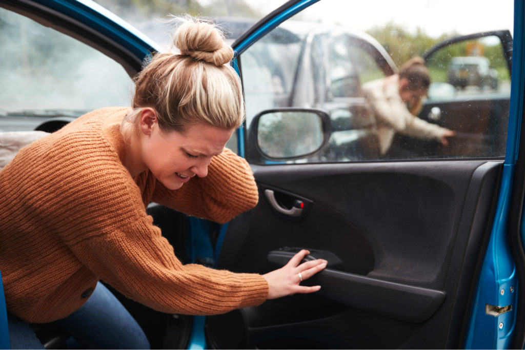 A lady in pain after a car wreck